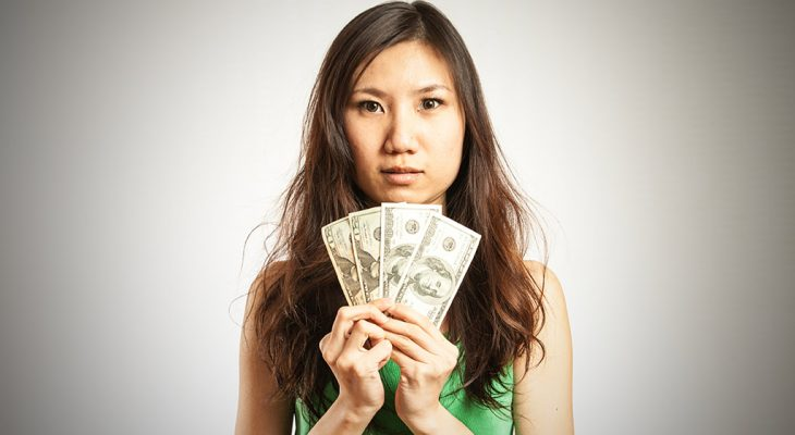 asian woman holding money